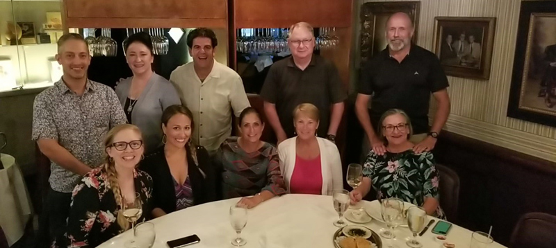 Faculty and students at dinner during NASW/TX