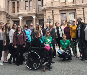 Students and faculty outside of the Texas State Capitol building